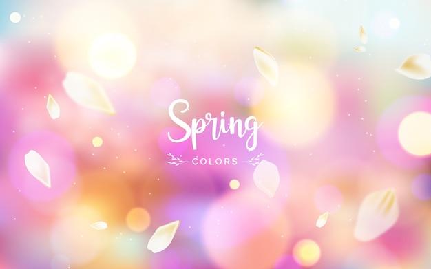Arrière-plan flou avec lettrage de couleurs de printemps