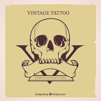 Arrière-plan de la main dessiné tatouage de crâne