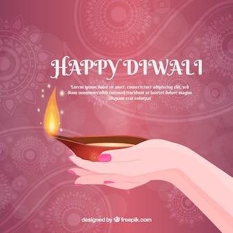 Arrière-plan des mains avec une lampe à huile de diwali