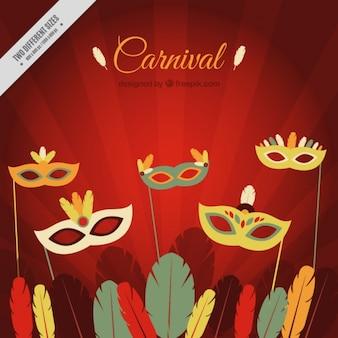 Arrière-plan de masques de carnaval avec des plumes