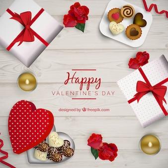 L'arrière-plan de la saint-valentin avec des cadeaux et des bonbons