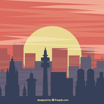 Arrière-plan avec des silhouettes de construction au coucher du soleil