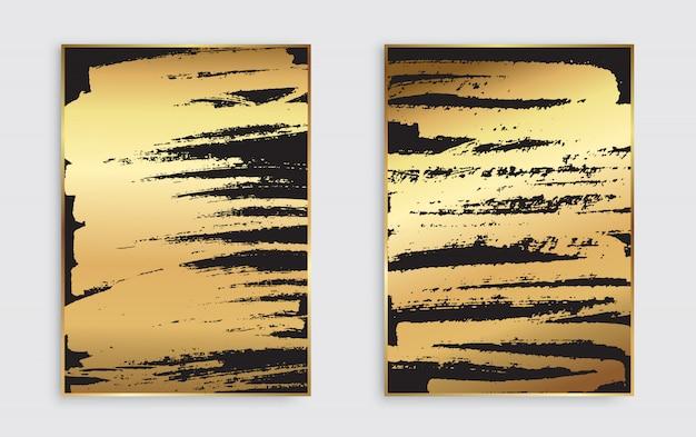 Arrière-plans de coups de pinceau or et noir