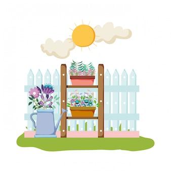 Arroseur de jardin avec clôture dans le champ