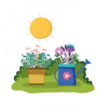 Arroseur de jardin avec plante d'intérieur dans le parc