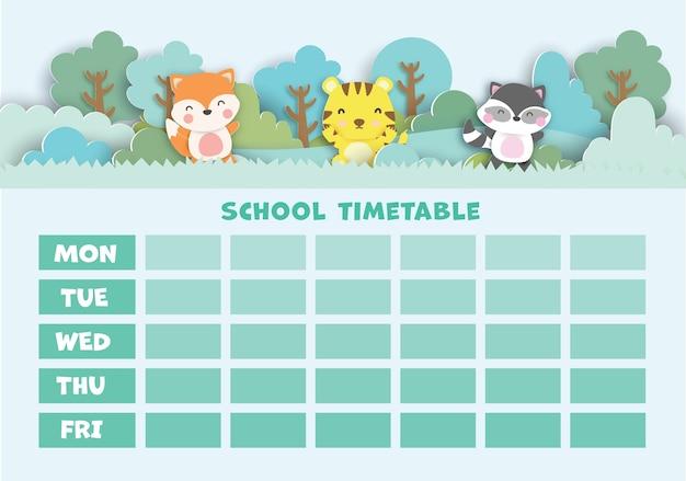 Art de papier retour au calendrier scolaire avec des animaux mignons dans la forêt