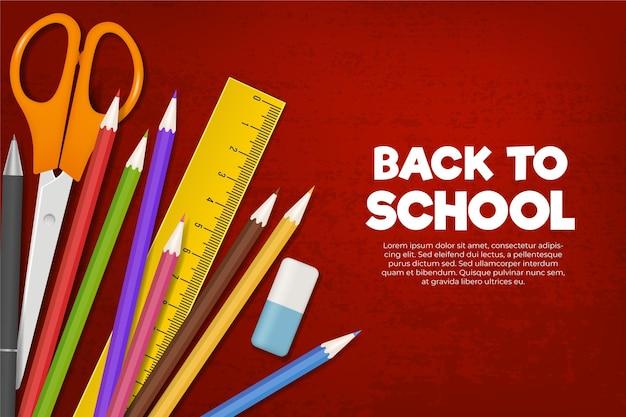 Articles de papeterie colorés au fond de l'école
