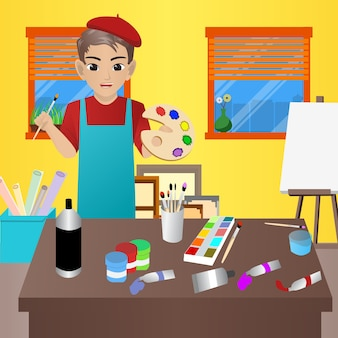 Artiste masculin tenant la brosse et la palette