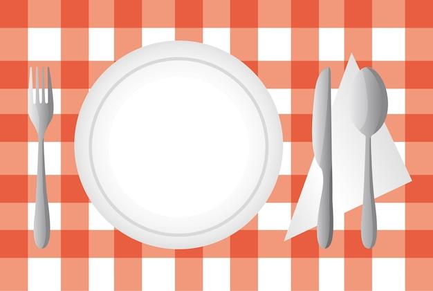 Assiette et couverts sur l'illustration vectorielle de nappe rouge