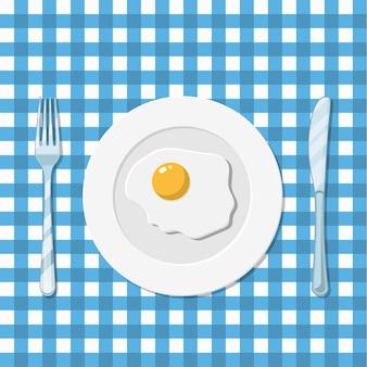 Assiette avec l'icône de l'oeuf au plat