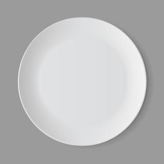 Assiette ronde vide blanche isolée, vue du dessus