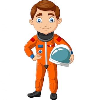 Astronaute de dessin animé garçon tenant un casque