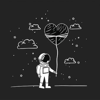 L'astronaute dessine avec le coeur