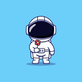 Astronaute mignon portant une fleur rouge