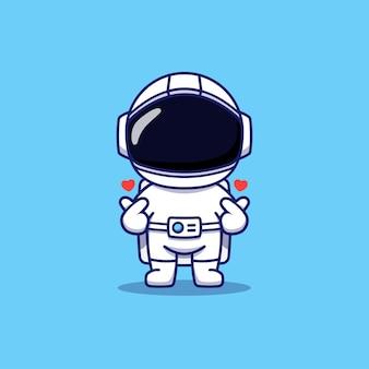 Astronaute mignon posant la main d'amour