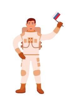 Astronaute russe tenant le drapeau national à la main sur blanc