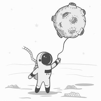 Astronaute tenant un ballon en forme de lune
