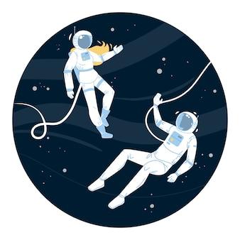 Astronautes en combinaison spatiale volant dans l'espace extra-atmosphérique