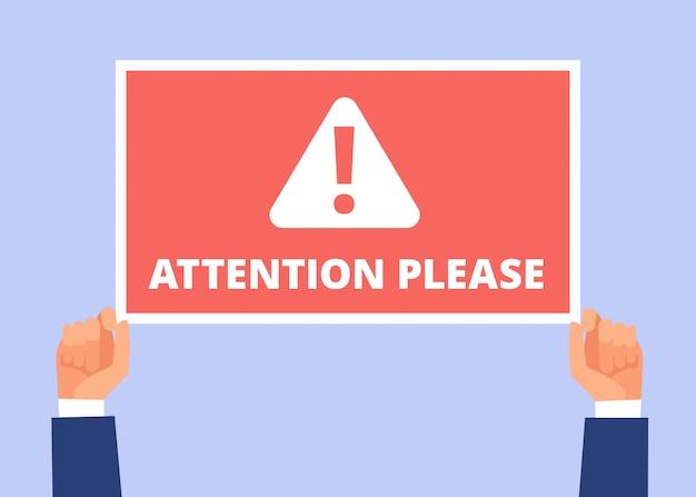 Attention, s'il vous plaît. les mains tiennent la bannière d'information avec un message important. annonce d'alerte, attention