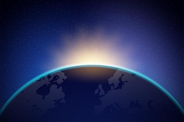 L'aube de l'espace. l'aube de l'espace. soleil levant derrière la terre
