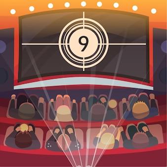 Auditorium de cinéma avec écran et sièges.