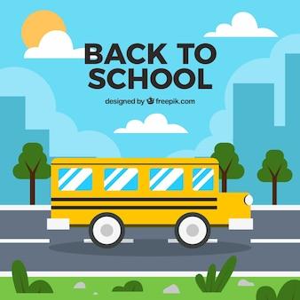 Autobus scolaire sur la route avec un design plat