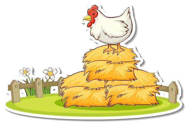 Autocollant un poulet debout sur une botte de foin