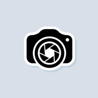 Autocollant pour appareil photo. appareil photo avec l'icône de l'objectif. notion de photographie. vecteur sur fond isolé. eps 10.