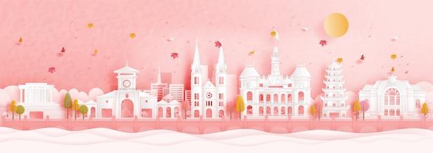 Automne à ho chi minh-ville, vietnam avec la chute des feuilles et des monuments de renommée mondiale en illustration vectorielle de papier découpé style