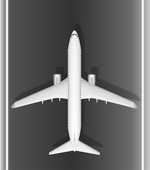Un avion blanc de passagers à réaction moderne sur la piste. vue d'en-haut. une image bien conçue avec une masse de petits détails. copiez l'espace.