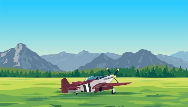 L'avion est dans l'aérodrome le terrain avec les montagnes en arrière-plan l'avion sur le terrain
