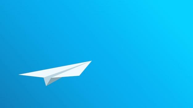 Avion en papier sur bleu