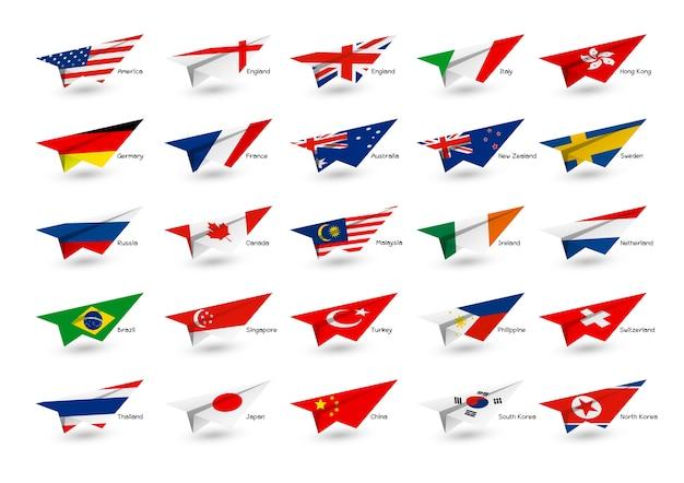 Avion en papier avec le drapeau du pays sur fond blanc