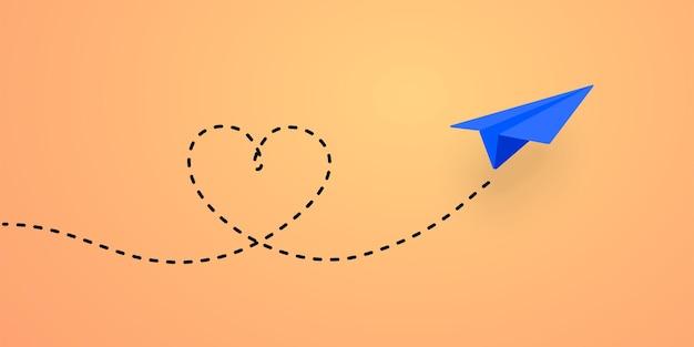 Avion en papier et illustration de chemin en forme de coeur