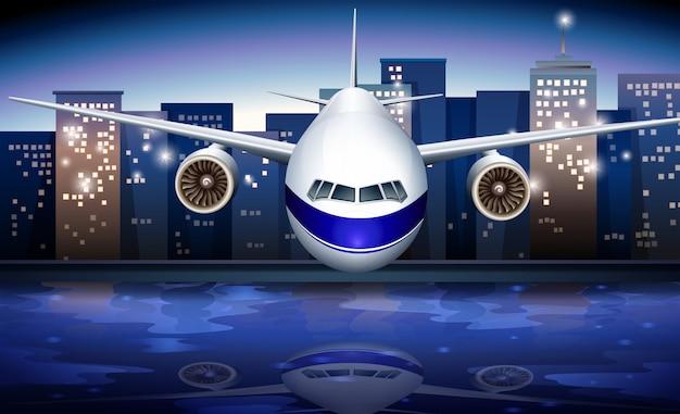 Un avion près des grands immeubles