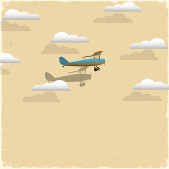 Avion rétro et nuages de papier