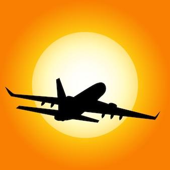 Avion en vol sur un coucher de soleil en arrière-plan