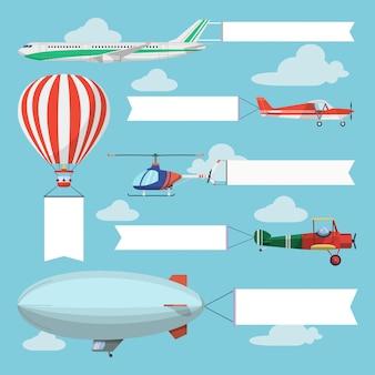 Avions volants, hélicoptère et dirigeable tirant une bannière publicitaire