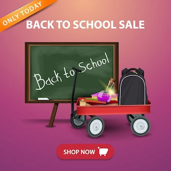 Bacl à la vente de l'école, baanner avec chariot de jardin avec des fournitures scolaires