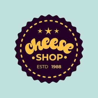 Badge de magasin de fromage sur bleu