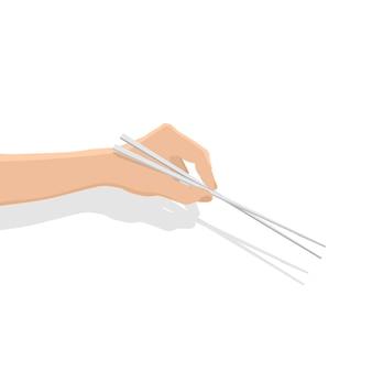 Baguettes d'utilisation à la main sur fond blanc.