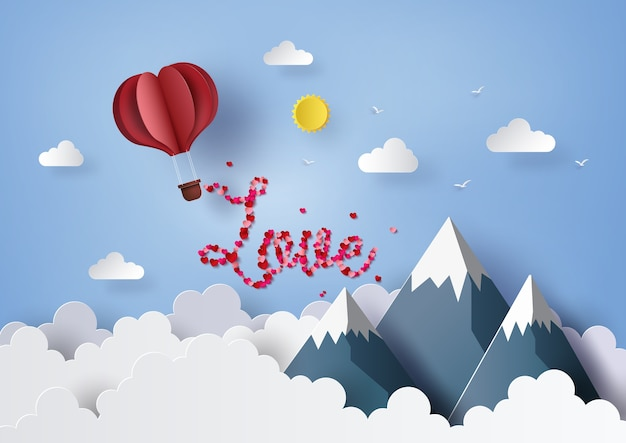 Ballon à air chaud origami coeur rouge voler dans le ciel bleu