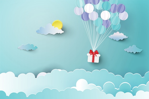 Ballon au-dessus des nuages avec un cadeau.
