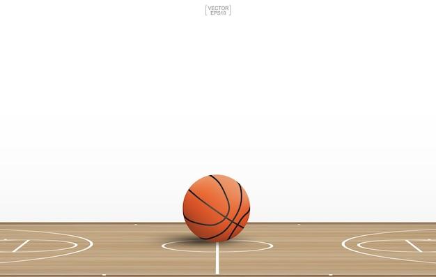 Ballon de basket sur un terrain en bois.