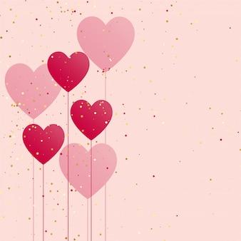 Ballon coeurs avec des confettis dorés