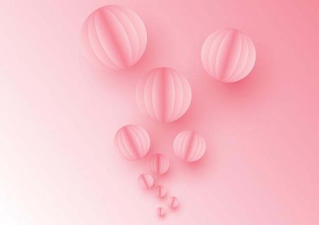 Ballon coloré sur fond rose