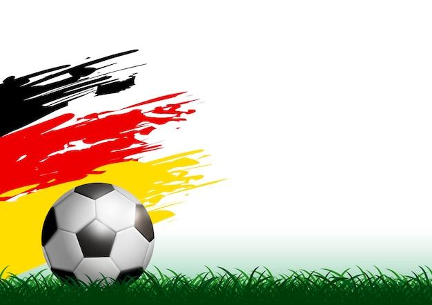 Ballon de foot sur l'herbe avec un pinceau