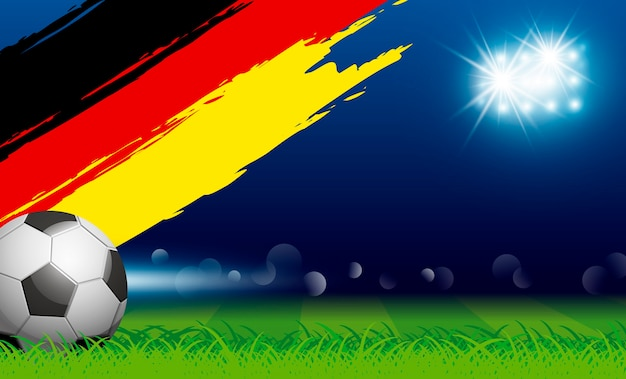 Ballon de football sur l'herbe et le drapeau de l'allemagne de pinceau