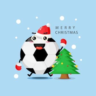 Ballon de football mascotte mignon heureux de célébrer le jour de noël