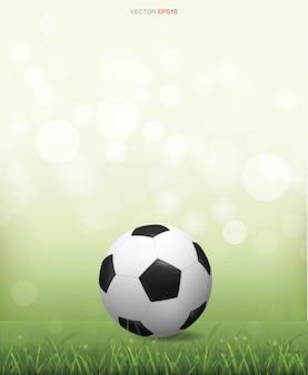 Ballon de football soccer sur terrain d'herbe verte avec fond flou clair flou. illustration vectorielle.